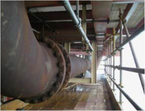 Hot pipework suffering from extensive corrosion under insulation (CUI) offshore