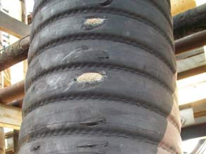 Scuffed and torn oil suction and discharge hose